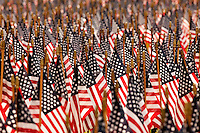 """Exactly 2,997 flags (one for each victim of 9/11) were placed in the shape of the Twin Towers near downtown Charlotte in September 2009 in memory of those who lost their lives on Sept. 11, 2001. The flags for """"Flags of Remembrance,"""" placed on Sept. 9, 2009, were coordinated by the Firefighter Steven Coakley Foundation. Coakley was a firefighter on FDNY Engine 217 who died on 9/11. The flags were placed at the Palmer Building, 2601 E. 7th St., Charlotte, NC."""