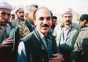 Iraq 2003   In Bibar, Dr. Khayri Namo Sheikhani, a Yezidi with the KDP peshmergas who just liberated the village used by Saddam Hussein as a forcible resettlment     Irak 2003 A Bibar, le Docteur Khayri Namo Sheikhani, un Yezidi, avec les peshmergas du KDP qui viennent de libérer le village utilisé par Saddam Hussein comme regroupement forcé de la population.
