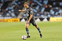 SAINT PAUL, MN - MAY 12: Chase Gasper #77 of Minnesota United FC with the ball during a game between Vancouver Whitecaps and Minnesota United FC at Allianz Field on May 12, 2021 in Saint Paul, Minnesota.