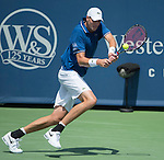 John Isner, (USA) defeats Juan Martin Del Potro (ARG) 6-7, 7-6, 6-3 at the Western & Southern Open in Mason, OH on August 17, 2013.