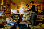 ELVIS FAN, DEBBIE CONSTABLE & HER BABY (LISA MARIE) WATCHING HER MOTHER,  VALERIE CONSTABLE,  AND BROTHER DANCING TO ELVIS RECORDS IN THE LIVING ROOM OF HER MOTHER'S SOUTH LONDON HOME