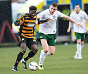 Alloa's Isaac Layne holds off Hib's Paul Hanlon.