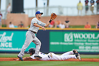 Biloxi Shuckers second baseman Nick Shaw (1) waits for a throw as Juan Perez (2) slides into second on a stolen base during the second game of a double header against the Pensacola Blue Wahoos on April 26, 2015 at Pensacola Bayfront Stadium in Pensacola, Florida.  Pensacola defeated Biloxi 2-1.  (Mike Janes/Four Seam Images)