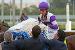 HALLANDALE BEACH, FL -APRIL 02:  Scenes from the Florida Derby.  #4 Nyquist (KY) with jockey Mario Qutierrez after winning the Florida Derby GI on April 2nd, 2016 at Gulfstream Park in Hallandale Beach, Florida. (Photo by Liz Lamont/Eclipse Sportswire/Getty Images)