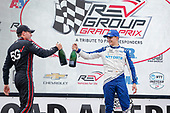 #10: Alex Palou, Chip Ganassi Racing Honda celebrates winning, #12: Will Power, Team Penske Chevrolet, champagne