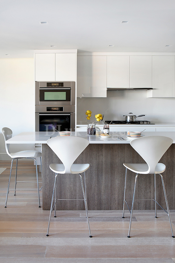 Open plan kitchen with bar stools