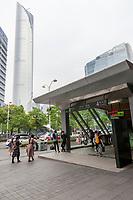 Suzhou, Jiangsu, China.  Entrance to an Underground Metro Station.  International Financial Center, Tallest Building in Jiangsu, in background.