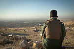 13/11/2015-- Iraq,Sinjar -- One of the Yizidian peshmarga awaits for an order to take control of Sinjar again.