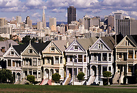 "San Francisco, California - Alamo Square Victorians in Foreground, San Francisco in Background.  Built in 1895, these houses are in the 700 block of Steiner Road, sometimes referred to as ""Postcard Row.""  The Transamerica and Bank of America buildings stand out in the city skyline."