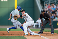 Chris Marrero (14) of the Charlotte Knights waits for a pick-off throw as Ryan Brett (1) of the Durham Bulls heads back towards first base at BB&T BallPark on July 22, 2015 in Charlotte, North Carolina.  The Knights defeated the Bulls 6-4.  (Brian Westerholt/Four Seam Images)