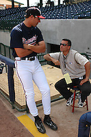 "19 April 2005: Dayton Moore, Director of Player Personnel for the Atlanta Braves, right, is shown here with Jeff Francoeur, one of his prize players. Moore was named No. 1 in Baseball America's ""Top 10 General Manager Prospects"" before the 2004 season and one of the ""Up-And-Coming Power Brokers"" in March 2005. He is credited with bringing along the rookies who have made significant contributions to the Atlanta lineup this year. (Tom Priddy/Four Seam Images)"