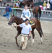 Ryan Curatolo and Street Game return after the Hill Prince Stakes at Belmont Park.