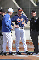 University of Virginia Cavaliers head coach Brian O'Conner #26 meeting at home plate before a game against the University of Kentucky Wildcats at Brooks Field on the campus of the University of North Carolina at Wilmington on February 14, 2014 in Wilmington, North Carolina. Kentucky defeated Virginia by the score of 8-3. (Robert Gurganus/Four Seam Images)