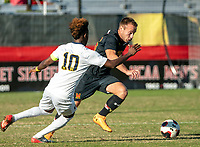 COLLEGE PARK, MD - NOVEMBER 03: Ben Di Rosa #25 of Maryland dribbles past Umar Farouk Osman #10 of Michigan during a game between Michigan and Maryland at Ludwig Field on November 03, 2019 in College Park, Maryland.
