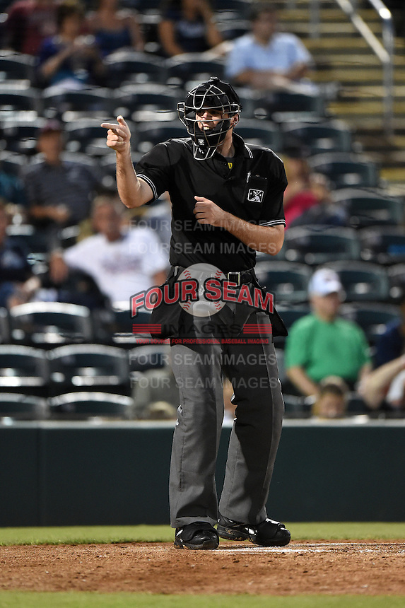 Home plate umpire Nate Tomlinson makes a call during a game between the St. Lucie Mets and Fort Myers Miracle on April 18, 2014 at Hammond Stadium in Fort Myers, Florida.  St. Lucie defeated Fort Myers 15-9.  (Mike Janes/Four Seam Images)