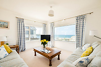 BNPS.co.uk (01202 558833)<br /> Pic: JohnBray&Partners/BNPS<br /> <br /> 'Kensington on Sea'....<br /> <br /> A seemingly unremarkable four bedroom home has emerged on the market for a whooping £1.85million - because of its amazing Atlantic views.<br /> <br /> Trequite, which was built in the late 1940s, directly overlooks Polzeath beach which is a favourite of A list celebrities, politicians and royalty.<br /> <br /> Princes William and Harry, and former prime minister David Cameron, are among the famous faces who have been spotted surfing at the Cornish beauty spot which has been labelled 'Kensington on Sea'.<br /> <br /> The slate four bedroom property was one of the first to be built on that section of the clifftop.<br /> <br /> It is being sold with estate agent John Bray & Partners.