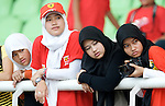 05 Apr 2009, Kuala Lumpur, Malaysia --- Muslim young girls Ferrari fans attend the 2009 Fia Formula One Malasyan Grand Prix at the Sepang circuit near Kuala Lumpur. Photo by Victor Fraile --- Image by © Victor Fraile / The Power of Sport Images