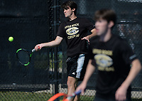 Little Rock Centrals' Stefan Tudoreanu (left) returns a shot Tuesday, Oct. 12, 2021, as he and doubles partner Alex Wells compete during the 6A state tennis finals at Memorial Park in Bentonville. Visit nwaonline.com/211013Daily/ for today's photo gallery.<br /> (NWA Democrat-Gazette/Andy Shupe)
