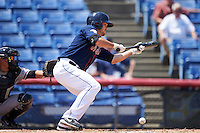 Binghamton Mets starting pitcher Tyler Pill (20) lays down a bunt during a game against the Richmond Flying Squirrels on June 26, 2016 at NYSEG Stadium in Binghamton, New York.  Binghamton defeated Richmond 7-2.  (Mike Janes/Four Seam Images)