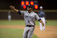 AZL Padres 1 first base coach Steven Negron (12) during an Arizona League game against the AZL Padres 2 at Peoria Sports Complex on July 14, 2018 in Peoria, Arizona. The AZL Padres 1 defeated the AZL Padres 2 4-0. (Zachary Lucy/Four Seam Images)