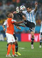 Ezequiel Lavezzi of Argentina and Georginio Wijnaldum of Netherlands in action