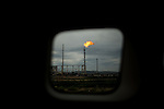 Travel scenes of Wyoming through the window of a rented Mazda M5...The Sinclair Refinery in Sinclair, Wyoming.