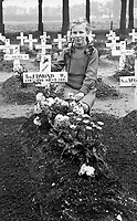 BNPS.co.uk (01202 558833)<br /> Pic: WillemienRieken/BNPS<br /> <br /> Willemien(9) at Trooper Edmunds grave in 1945  before a gravestone had been erected.<br /> <br /> As the 75th anniversary of Operation Market Garden begins tomorrow, one of the original 'flower girl''s of Arnhem is still remembering...<br /> <br /> A heartwarming tale of dedication and rememberance has been revealed over a remarkable Dutch pensioner who still tends the grave of a fallen British Arnhem hero, 75 years after he perished in battle.<br /> <br /> Every year, Willemien Rieken (84) still lays flowers at Oosterbeek War Cemetery in memory of Trooper William Edmond, who was shot by a German sniper in the early stages of Operation Market Garden in 1944.<br /> <br /> Trp Edmond, of the elite 1st Airborne Reconnaissance Squadron's final words, uttered to two comrades who came to his aid, were 'tell my wife I love her'.<br /> <br /> Willemien was just nine years old when Oosterbeek became a bloody battleground in September 1944. The retired director's secretary, now aged 84, hid in a small cellar underneath her father's confectionary shop for five days while fierce fighting raged around their house and garden.<br /> <br /> Twenty-five of her family, friends and neighbours packed into the confined space and cowered in fear in the deafening din of shooting and explosions.<br /> <br /> After the war the grateful citizens of Arnhem arranged a poignant ceremony involving a nine year old Willimein and other school children from the town, to lay flowers at the graves of the British soldiers killed in the battle. <br /> <br /> And the dedicated pensioner is now one of the last survivors to still undertake the task.