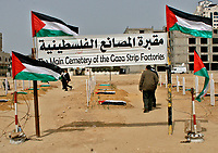 """Palestinians walk near a fake cemetery to represent the diminishing number of factories in Gaza, during a protest calling for an end of the Israeli siege to the Gaza Strip March 18, 2008.""""photo by Fady Adwan"""""""