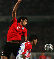 Egypt's Salah Soliman (2) falls after missing out on a header against   Costa Rica's Josue Martinez (17) during the FIFA Under 20 World Cup Round of 16 match between Egypt and Costa Rica at the Cairo International Stadium on October 06, 2009 in Cairo, Egypt.