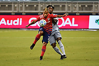 KANSAS CITY, KS - SEPTEMBER 02: Reggie Cannon # 2 of FC Dallas controls the ball in front of Gerso Fernandes #12 of Sporting Kansas City during a game between FC Dallas and Sporting Kansas City at Children's Mercy Park on September 02, 2020 in Kansas City, Kansas.