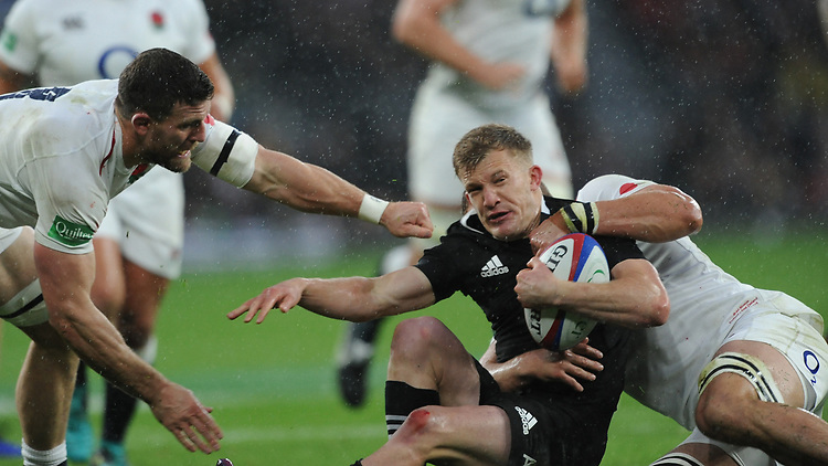 Damian McKenzie of New Zealand is tackled by Brad Shields as Mark Wilson of England supports during the Quilter International match between England and New Zealand at Twickenham Stadium on Saturday 10th November 2018 (Photo by Rob Munro/Stewart Communications)