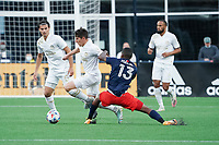 FOXBOROUGH, MA - MAY 1: Michael Mancienne #13 of New England Revolution stretches to tackle Emerson Hyndman #20 Midfielder of Atlanta United FC during a game between Atlanta United FC and New England Revolution at Gillette Stadium on May 1, 2021 in Foxborough, Massachusetts.