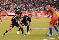 EAST RUTHERFORD, NJ - SEPTEMBER 6: Christian Pulisic #10 of the United States battles for the ball with Jorge Sanchez #21 of Mexico, Hector Herrera #16 of Mexico during a game between Mexico and USMNT at MetLife Stadium on September 6, 2019 in East Rutherford, New Jersey.