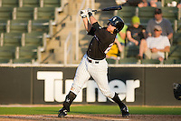 Nicholas Ciolli #20 of the Kannapolis Intimidators follows through on his swing against the West Virginia Power at Fieldcrest Cannon Stadium April 25, 2010, in Kannapolis, North Carolina.  Photo by Brian Westerholt / Four Seam Images