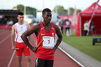Tuesday 15th July 2014<br /> Pictured: Christian Malcolm<br /> RE: Welsh Sprinter Christian Malcolm stands on the track with his hands on his hips, holding a relay baton about to compete in the 4x100m relay at the Welsh Athletics International in the Cardiff International Sports Stadium South Wales, UK. His last race on home soil.