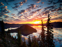 Sunrise on Crater Lake with Wizard Island.  Crater Lake National Park. Oregon