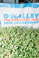 A campaign sign hangs near the roadside outside the campaign headquarters as Democratic presidential candidate and former governor of Maryland Martin O'Malley speaks to a small crowd at the kickoff of his New Hampshire campaign headquarters in Manchester, New Hampshire.