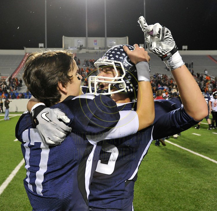 Greenwood quarterback Hayden Smith (L) celebrates with team mate Drew Morgan at the end of the class 5A State Championship at War Memorial Stadium in Little Rock. Greenwood beat Batesville 53-11 and Morgan earned MVP honors...Special to the Democrat-Gazette/JIMMY JONES