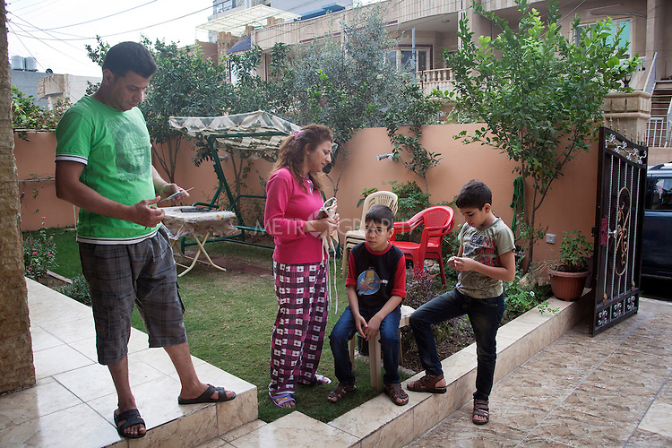 """10/31/14. Erbil, Iraq.<br /> At early morning Suzan spook to Wassam and Milad before they leaving, She said """"Now you are going back to Alqosh and please be good with School and keep study well and be good on the orphanage""""."""