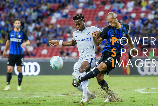 FC Internazionale Defender Joao Miranda (R) fights for the ball with Chelsea Forward Michy Batshuayi (L) during the International Champions Cup 2017 match between FC Internazionale and Chelsea FC on July 29, 2017 in Singapore. Photo by Marcio Rodrigo Machado / Power Sport Images