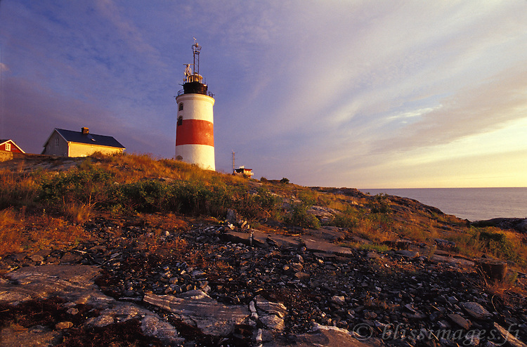 Söderarm Lighthhouse explodes with Nature's sunrise colours where the open Baltic Sea meets the Stockholm Archipelago of Sweden.