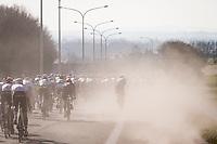 peloton fast descending in the dust<br /> <br /> 73rd Kuurne - Brussels - Kuurne 2021<br /> ME (1.Pro)<br /> 1 day race from Kuurne to Kuurne (BEL/197km)<br /> <br /> ©kramon