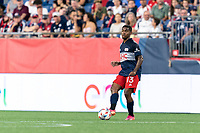FOXBOROUGH, MA - AUGUST 18: Maciel #13 of New England Revolution passes the ball during a game between D.C. United and New England Revolution at Gillette Stadium on August 18, 2021 in Foxborough, Massachusetts.