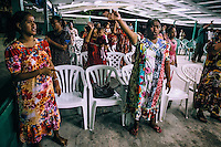 A night prayer at a church. Ebeye became a magnet for missionaries from many religious groups and churches for whom Ebeye is a convenient place to set up base and is itself populated by more than 13 thousand poor and socially deprived ideal potential recruits.