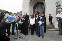 Pictured: Detective Constable for South Wales Police Charmaine Kinson (C) reads a statement on behalf of the family of tragic teen Rebeca Aylward, her mother Sonia is 2nd R  with her other daughter and son who Jack is holding a picture of Rebecca, standing outside Swansea Crown Court. Wednesday 27 July 2011<br /> Re: The jury on the trial of 17-year-old Joshua Davies who denies murdering his 15 year old ex-girlfriend Rebecca Aylward over an alleged bet for a free breakfast has found him guilty at Swansea Crown court.<br /> Rebecca was found dead in woods in Aberkenfig, near Bridgend, south Wales, in October 2010.