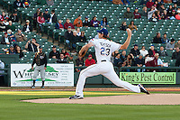 Round Rock Express pitcher Nick Tepesch #23 delivers the first pitch of the season against the Omaha Storm Chasers in the Pacific Coast League baseball game on April 4, 2013 at the Dell Diamond in Round Rock, Texas. Round Rock defeated Omaha in their season opener 3-1. (Andrew Woolley/Four Seam Images).