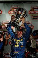 Nascar Craftsman Truck driver Bobby Hamilton celebrates after winning the 2004 championship. Mandatory Credit: Mark J. Rebilas