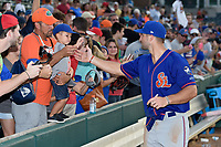 St. Lucie Mets left fielder Tim Tebow (15) signs autographs for fans after a game against the Florida Fire Frogs on July 23, 2017 at Osceola County Stadium in Kissimmee, Florida.  St. Lucie defeated Florida 3-2.  (Mike Janes/Four Seam Images)