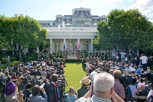 United States President Donald J. Trump and Prime Minister Narendra Modi of India deliver joint statements in the Rose Garden of the White House in Washington, DC on Monday, June 26, 2017. Photo Credit: Ron Sachs/CNP/AdMedia
