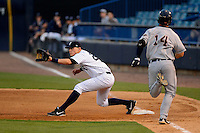 Tampa Yankees first baseman Matt Snyder #29 takes a throw as Jeff McVaney #14 runs up the base line during a game against the Lakeland Flying Tigers at Steinbrenner Field on April 6, 2013 in Tampa, Florida.  Lakeland defeated Tampa 8-3.  (Mike Janes/Four Seam Images)